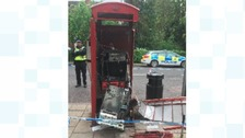 Phone box blown apart by thieves trying to steal cash machine inside