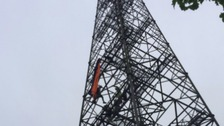 The two men got stuck on the phone mast near Halstead.