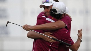 Ian Poulter hugs teammate Rory McIlroy