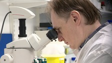A scientist works in the research lab at Astex Pharmaceuticals on Cambridge Science Park