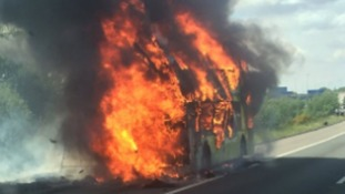 Schoolchildren escape burning bus on M6