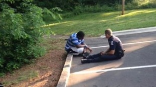 Officer Tim Purdy meets with an autistic man who had wandered off from school