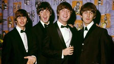 Paul McCartney (middle left) and John Lennon (middle right) wrote most of the Beatles' songs