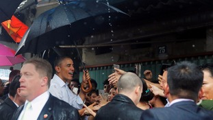 Obama stops off for $6 meal at streetside cafe in Vietnam