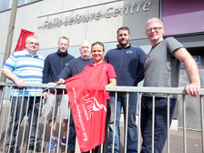 Staff gather outside the Falls Leisure Centre in Belfast.
