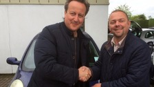 Iain Harris shaking David Cameron's hand