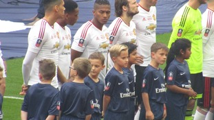 School boy Sam Hunter's dream came true when he walked out on the pitch with Manchester United as one of the team's mascots.