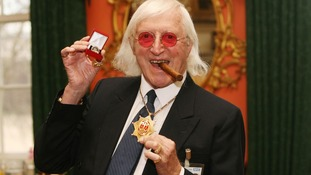 Sir Jimmy Savile after he received a commemorative badge from Prime Minister Gordon Brown at Downing Street in London for his work as a 'Bevin Boy'.