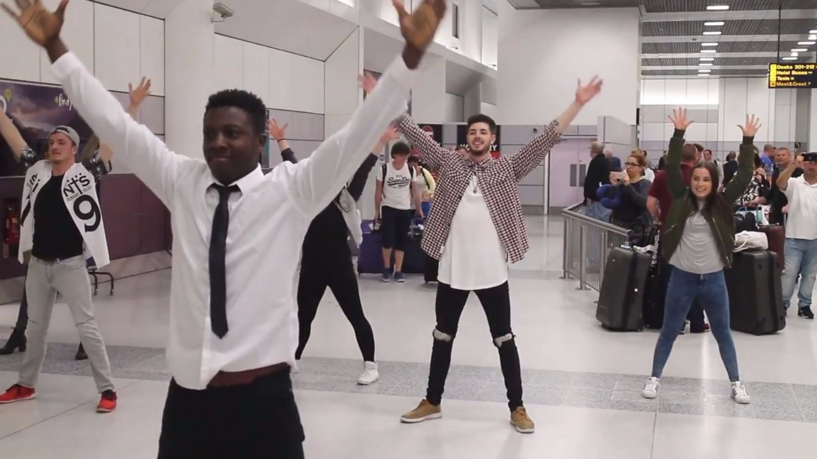 Woman Arrives Back From Holiday To Flash Mob Wedding Proposal