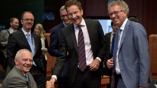 (L-R) Germany's Finance Minister Wolfgang Schauble chats with Eurogroup President Jeroen Dijsselbloem and Luxembourg's Finance Minister Pierre Gramegna.