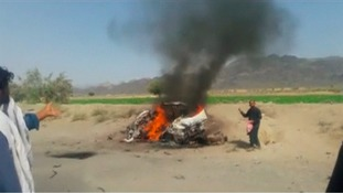 A car on fire at the site of a drone strike believed to have killed Afghan Taliban leader Mullah Akhtar Mansour