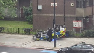 Police car flips onto its roof and ends up on pavement