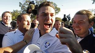 Team Europe golfer Kaymer celebrates winning his match against U.S. golfer Stricker
