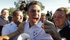 Team Europe golfer Kaymer celebrates winning his match against U.S. golfer Stricker