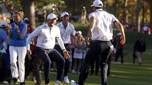 Kaymer celebrates winning his match against U.S. golfer Stricker to retain the Ryder Cup for Europe