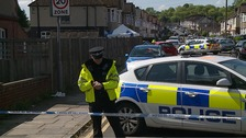 Police inspect the scene on Overstone Road.