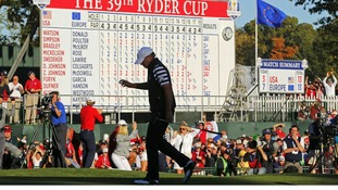 U.S. golfer Stricker walks off the 18th green after losing his match to Team Europe golfer Kaymer