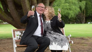 The couple raise a glass to their winnings