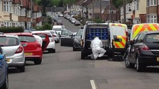 Police search the car in Luton today.