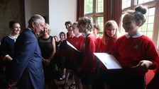 Prince Charles talking to schoolchildren on a visit to Donegal Castle.