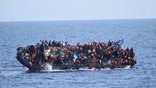 Dramatic photos capture moment migrant boat capsizes