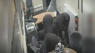 CCTV shows terrifying moment armed robbers ransack bank