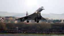 Passing overs thousands of spectators, Concorde touches down at Airbus UK's Filton airfield, Bristol, for the very last time