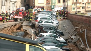 Giant sinkhole swallows dozens of cars along river in Florence