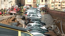 Giant sinkhole swallows dozens of cars in Florence