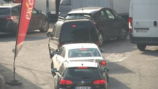 Motorists queue to get fuel at a filling station