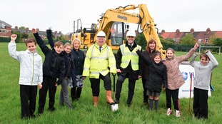 Councillor Stephen Parnaby OBE, Leader of East Riding of Yorkshire Council, Martin Hall, managing director of the Hall Construction Group (centre right) with Councillor Julie Abraham, portfolio holder for children, young people and education (left) and Liz Pollard, headteacher of St Nicholas Primary School, with some of the pupils.