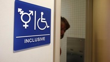 A toilet sign for transgender use