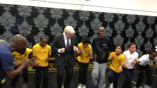 London Mayor Boris Johnson (left) with gold medallist Mo Farah.