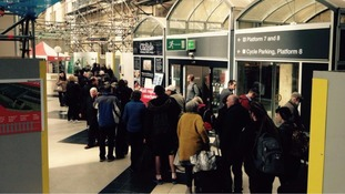 People queue for replacement buses at Carlisle Station in April.