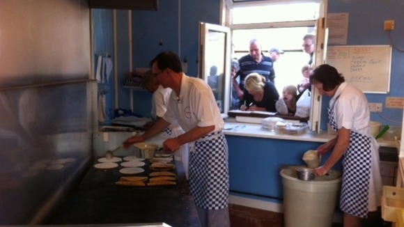 Owner cooking traditional oatcakes in the shop 