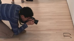 Prankster puts glasses on floor in gallery and fools people into thinking it is art