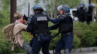 A protester is apprehended by police in Nantes.