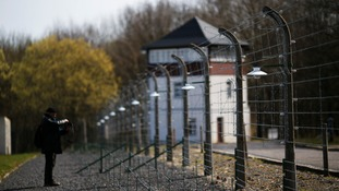 Police investigating Britons' 'Nazi salute' at death camp