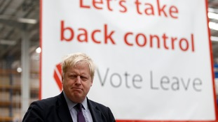 Boris Johnson with Vote Leave banner