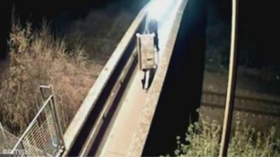 Search for vandals who threw bench on rail tracks