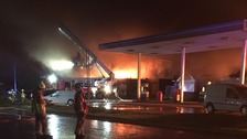 Fire crews fought to stop the fire at Clophill spreading to other buildings