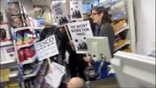 Protesters in a Tesco