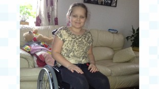 Katrina, who is 8, has to use a wheelchair now