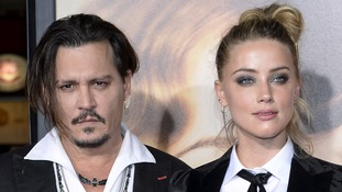 Johnny Depp ordered to stay away from wife after claims he 'hit her with iPhone'