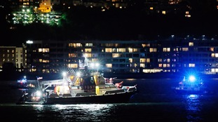 A boat searches for the wreckage of a vintage P-47 Thunderbolt airplane that crashed into the Hudson River on Friday evening.