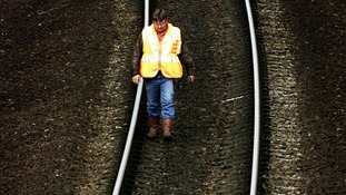 An engineer checks part of the West Coast train line.