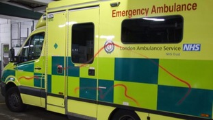 London Ambulance is sprayed with offensive graffiti.