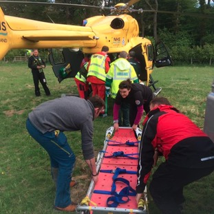 The Casualty being loaded into the Helimed Air Ambulance