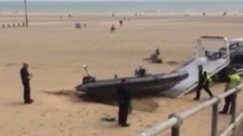 Two men charged over inflatable boat rescue