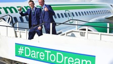 NI captain Steven Davis and manager Michael O'Neill board the plane.